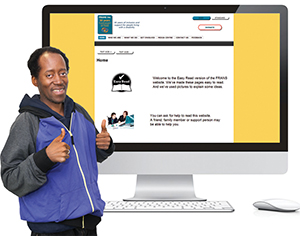 A man standing in front of a computer screen with an easy english website. He is giving a thumbs up.